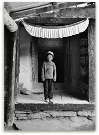 Child by monastery door photo